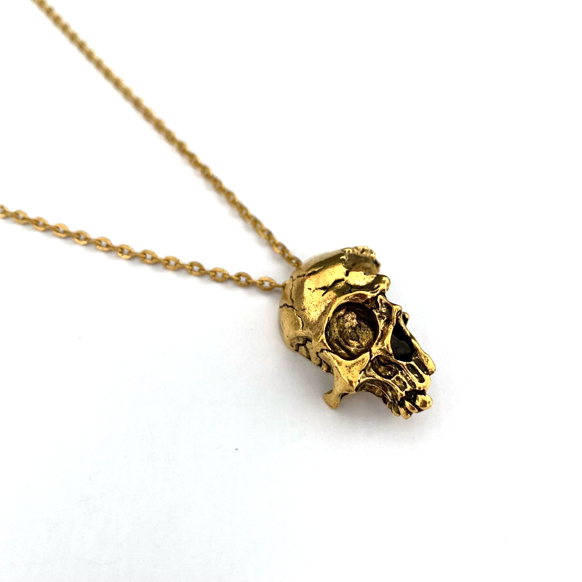 Edgy Cracked Half Skull Pendant Cable Chain Necklace for Dark Aesthetic Attires