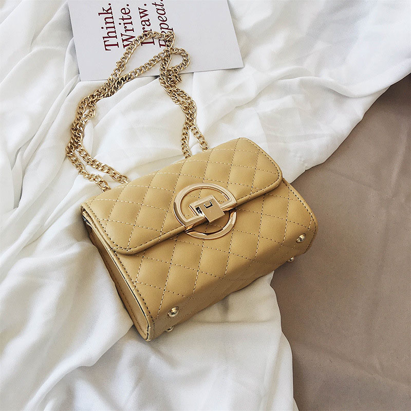 Circular Golden Buckle Quilted Trapezoid Bag for Fashionable Casual Looks