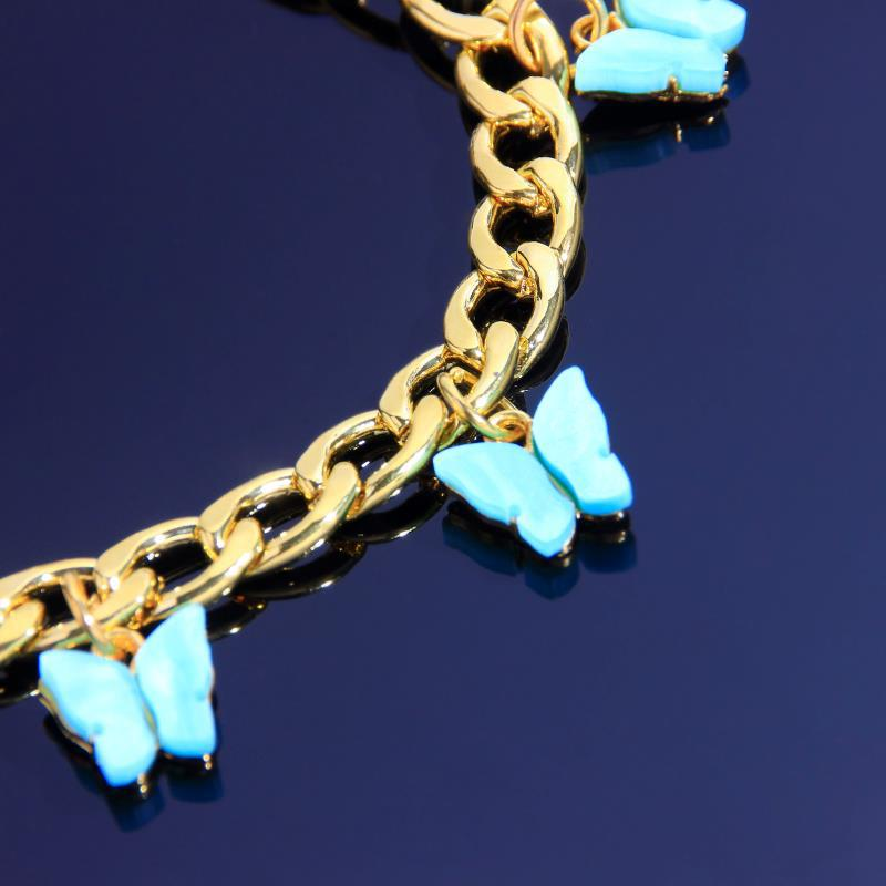 Golden Curb Chain Bracelet with Butterfly Charms for Chic Outfits