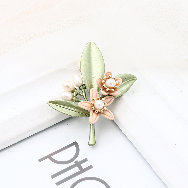 Vintage Flower with Green Leaves Pin for Nature-Friendly Events
