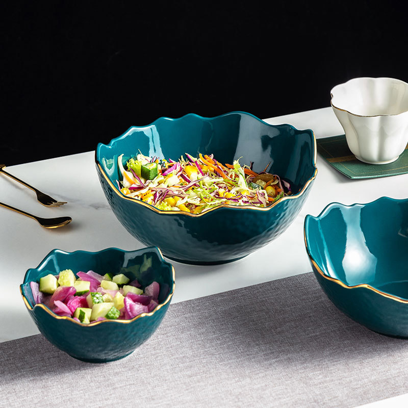 Artistic Textured Ceramic Bowl with Gold Lining for Food Presentations