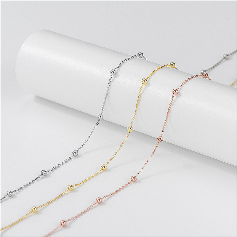 Sparse Bead and Cable Chain Necklace