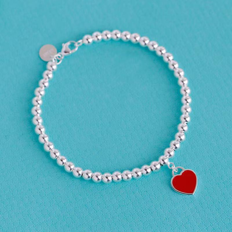 Fashionable Silver Beaded Necklace with Heart Pendant for Chic Girly Looks