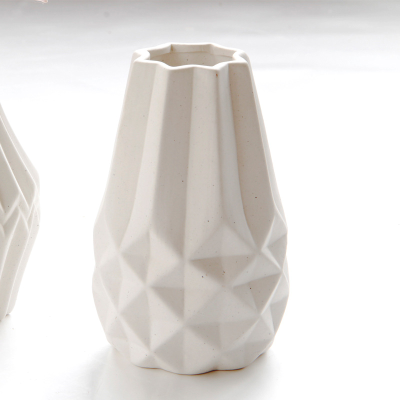 Multifaceted Surfaces Geometric White Vase for Unique Tabletops