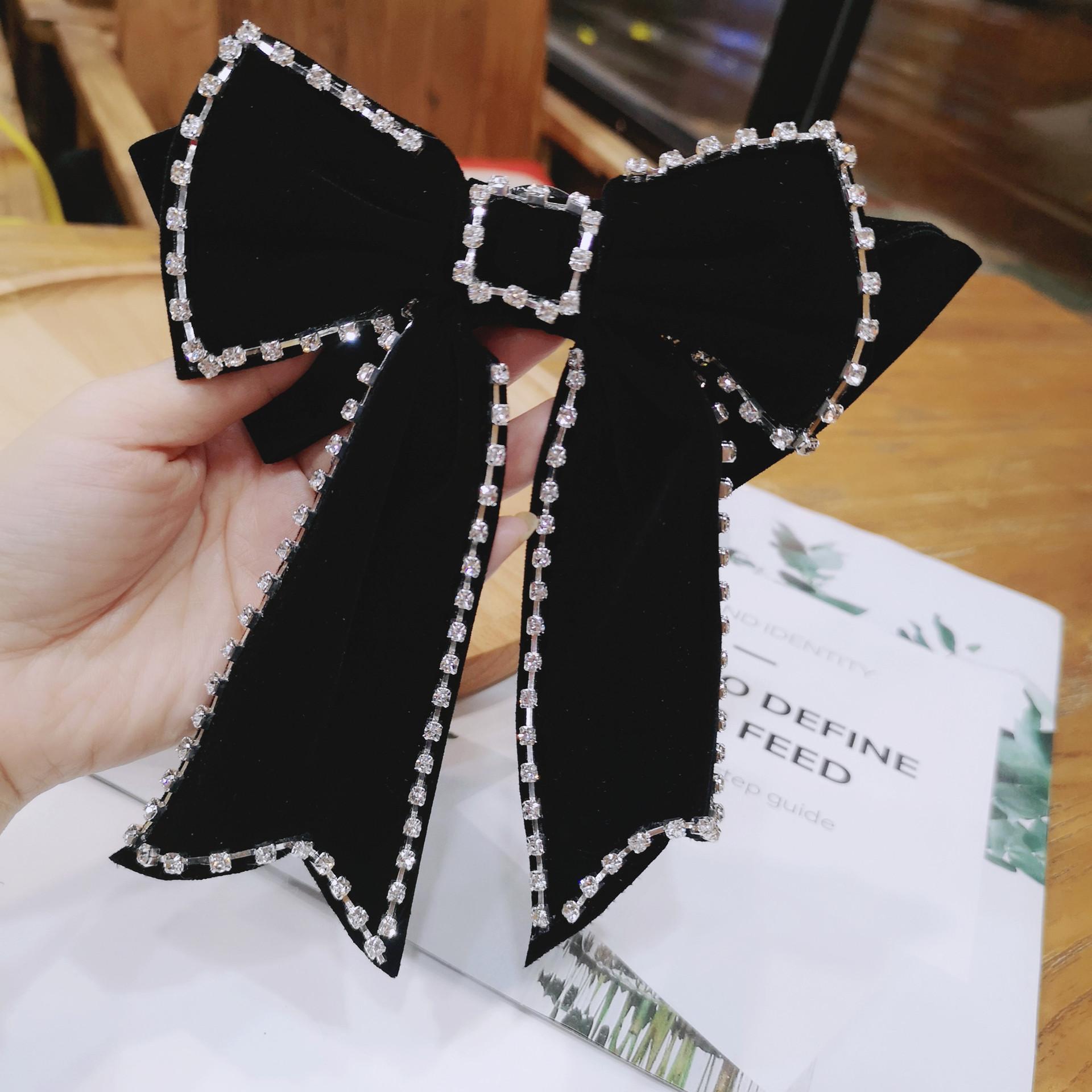 Sleek Rhinestone-Studded Black Ribbon Brooch for Pairing with Dress Shirts
