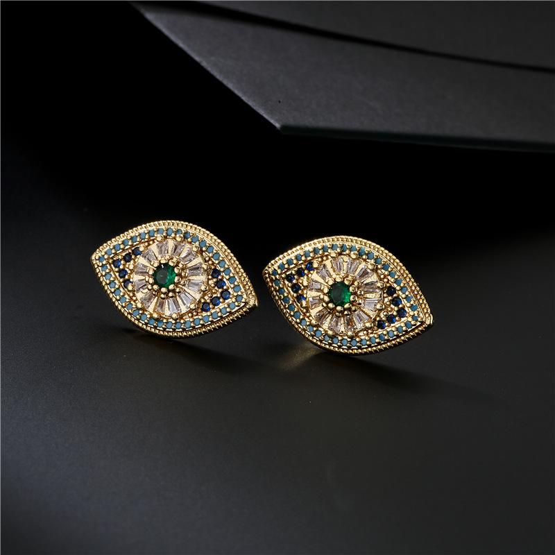 Elegant Eye-Shaped Faux Gold Earrings for Stylish Looks