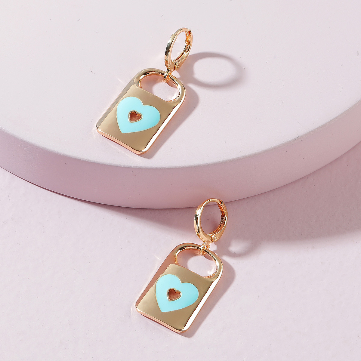 Stylish Huggie Earrings with Heart Lock Pendant for Sweet-Looking Outfits