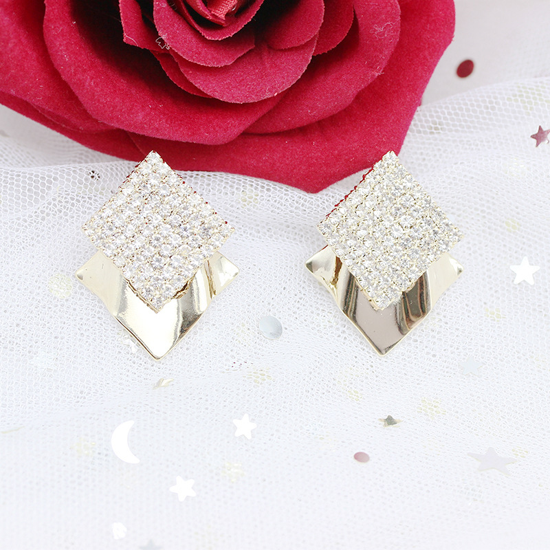 Extravagant Faux Diamond Stud Earrings for a Well-Dressed Aura